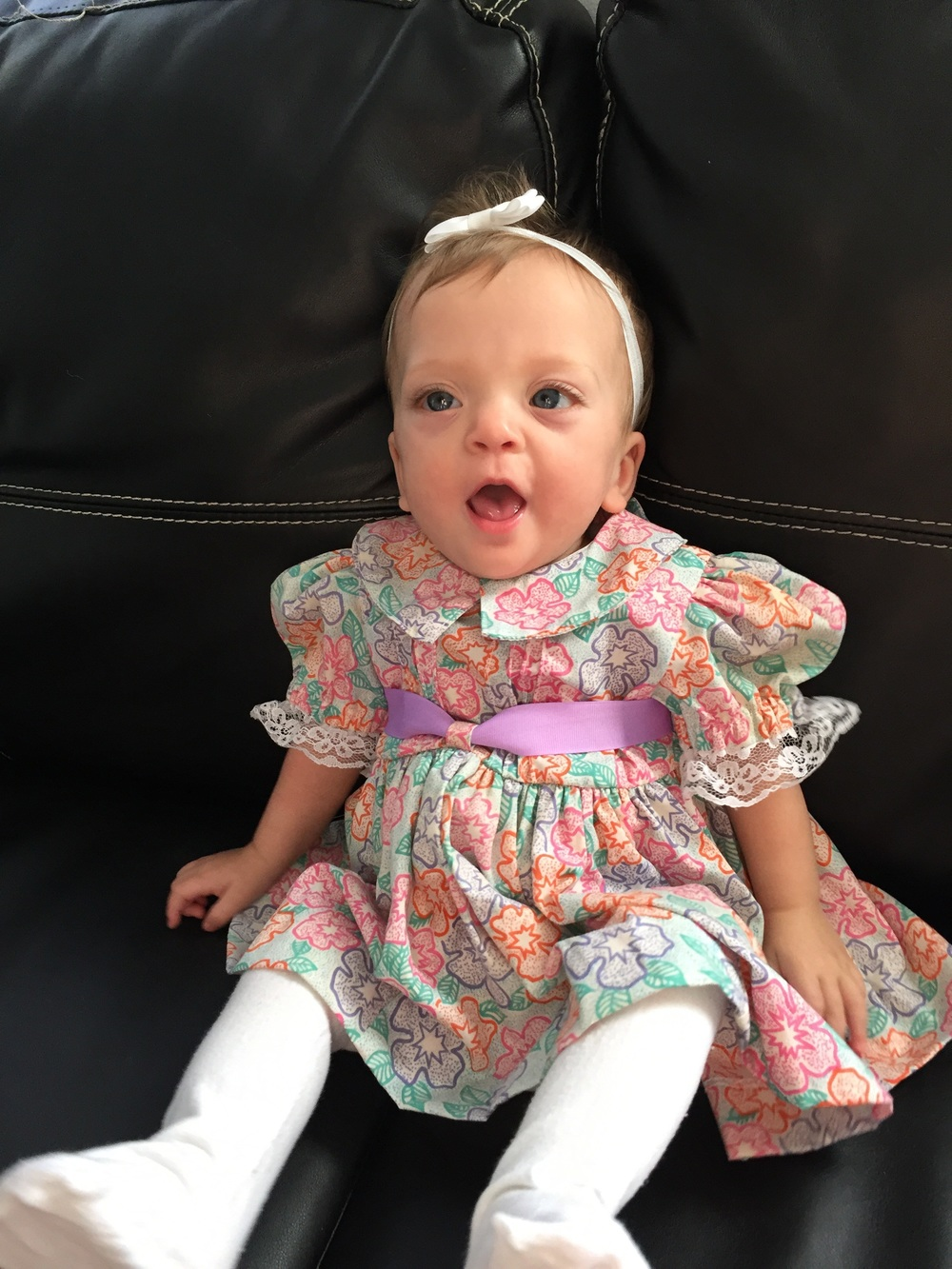 Lucie wearing a dress made from one of my favorite outfits as a child. My mom secretly saved it and had a friend make this for Lucie.