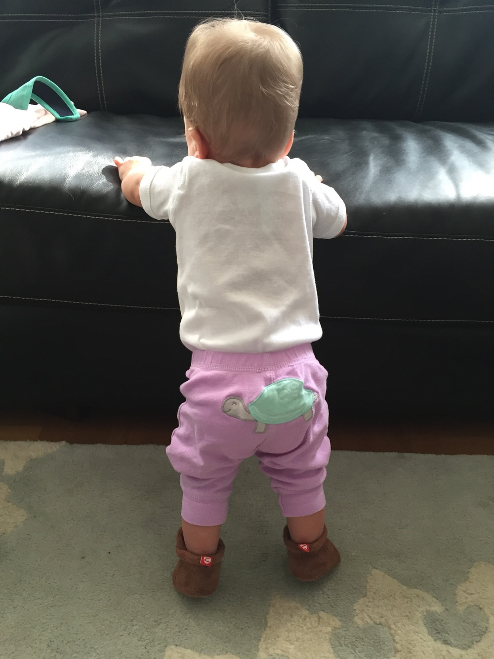 We know, we can't believe it either… she can stand while supporting herself.