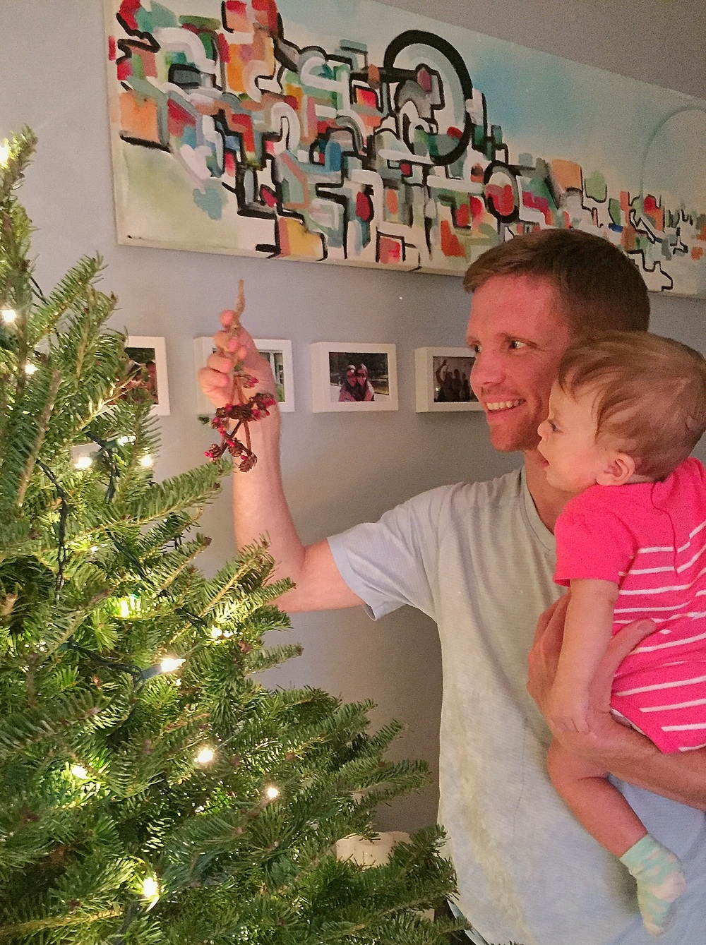Helping Papa decorate, she had so much fun, as you can tell.