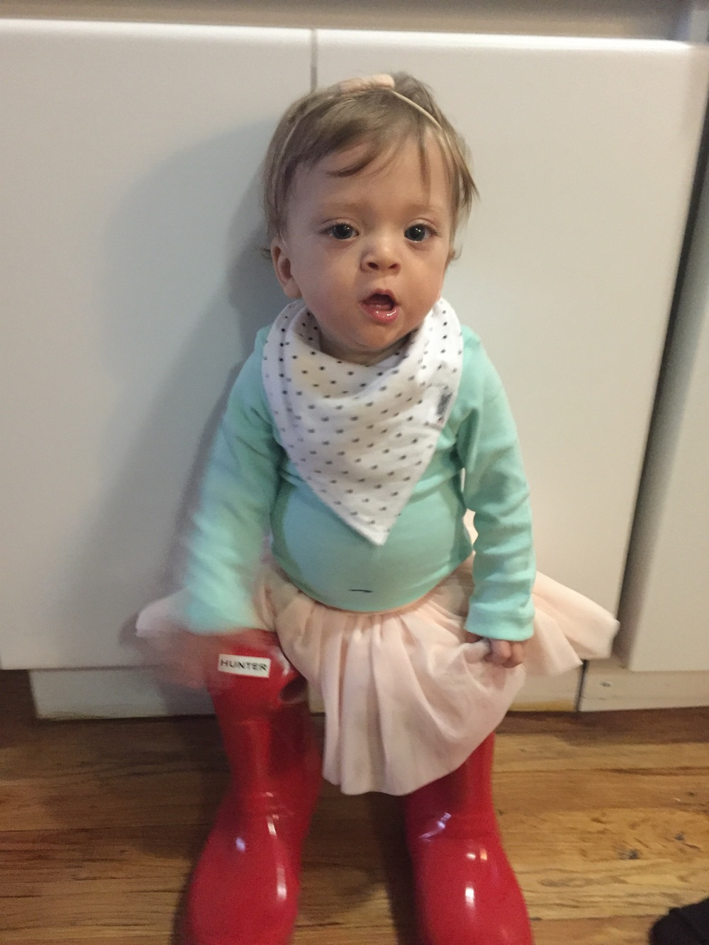 Wanted to try on mommy's boots.