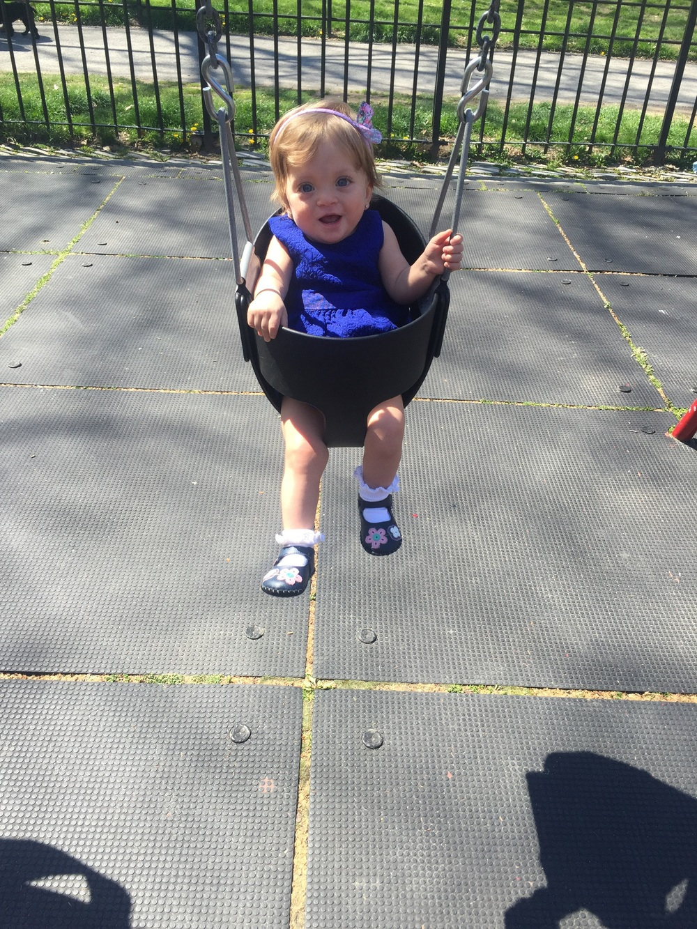 On the swings for the first time ever - at the playground at the 97th Street Entrance to Central Park