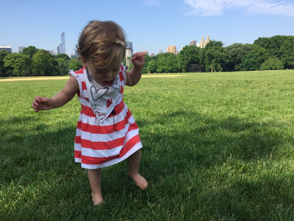 Our City Girl isn't too sure about the grass in her bare feet...