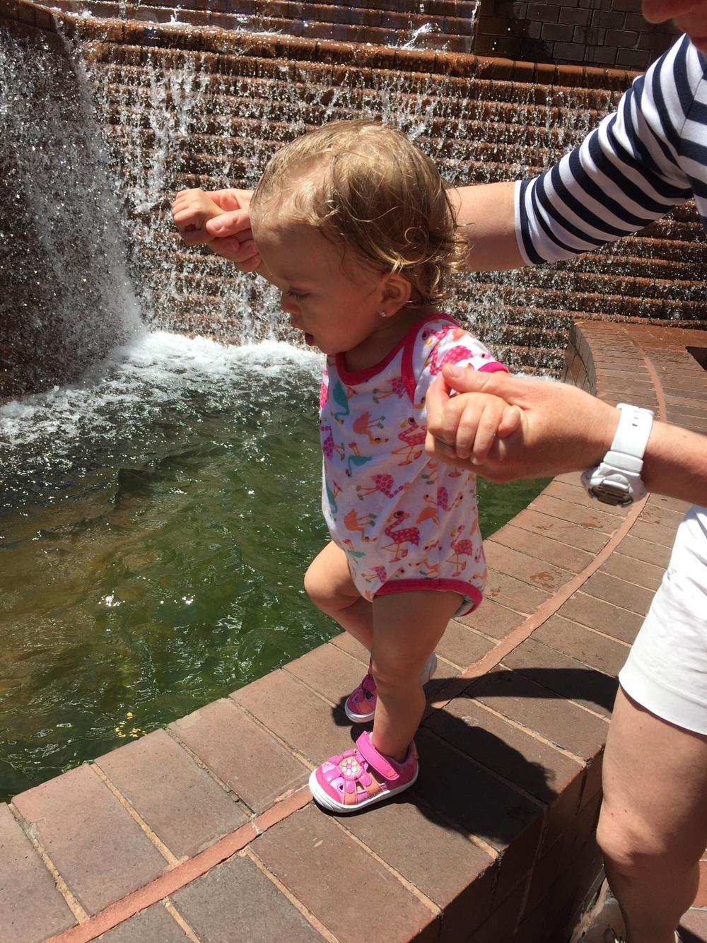 Walking along her favorite fountain.