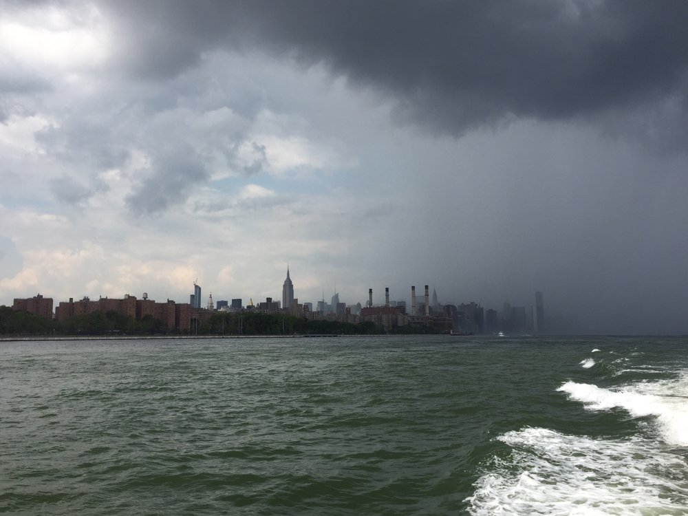 On the East River Ferry heading to Govenor's Island. Check out this storm chasing behind us.