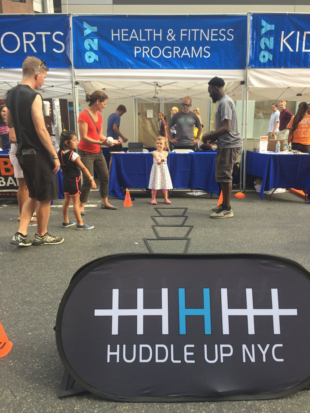 This was during the 92Y StreetFest in mid-September. Rob's company, Huddle Up NYC had a tent at the event where he was able to advertise a ton and do football drill demos!
