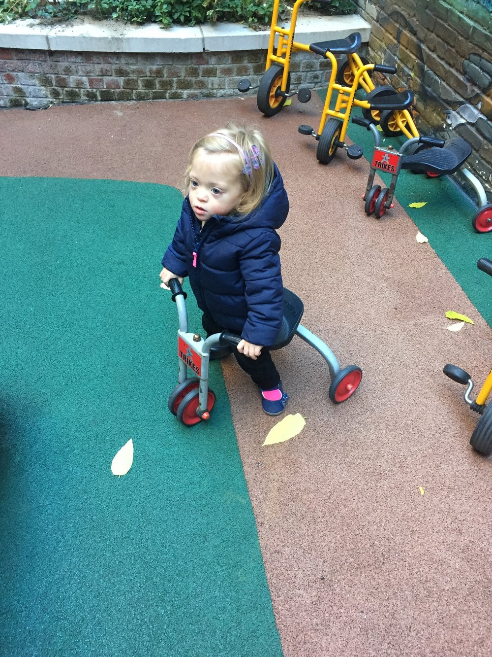 Playing on the Scooting Tricycle.