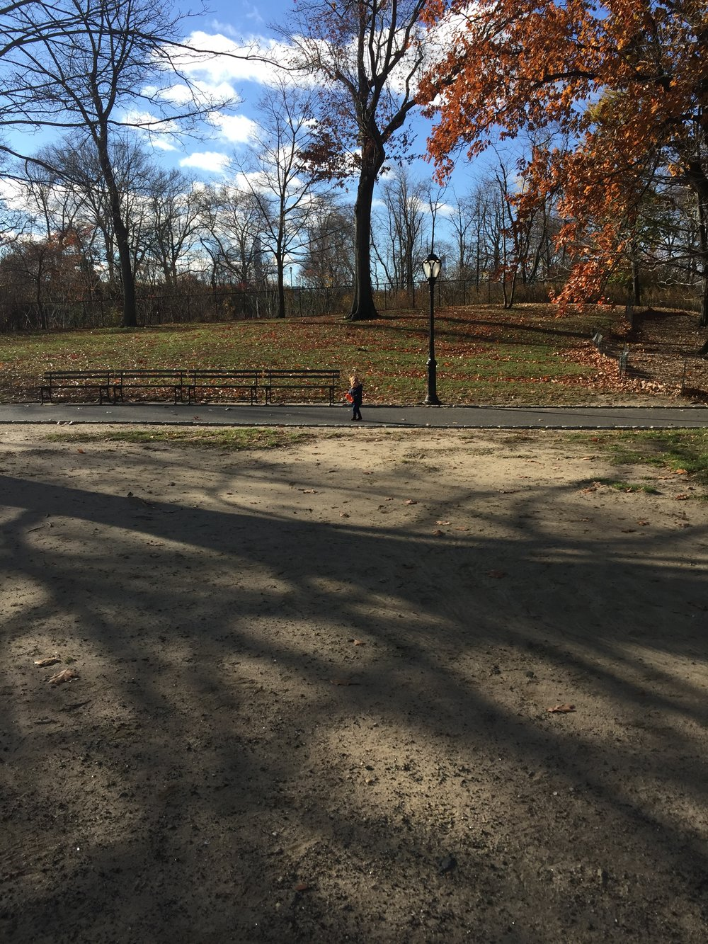 Little girl in the best park in the best city.