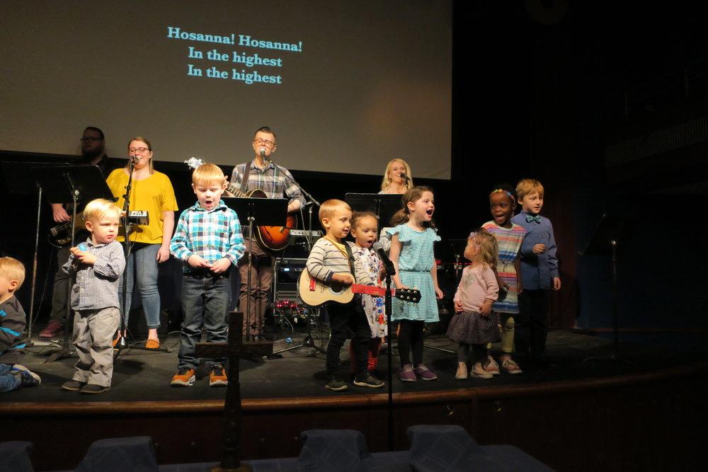 Apostles Kids singing on Palm Sunday