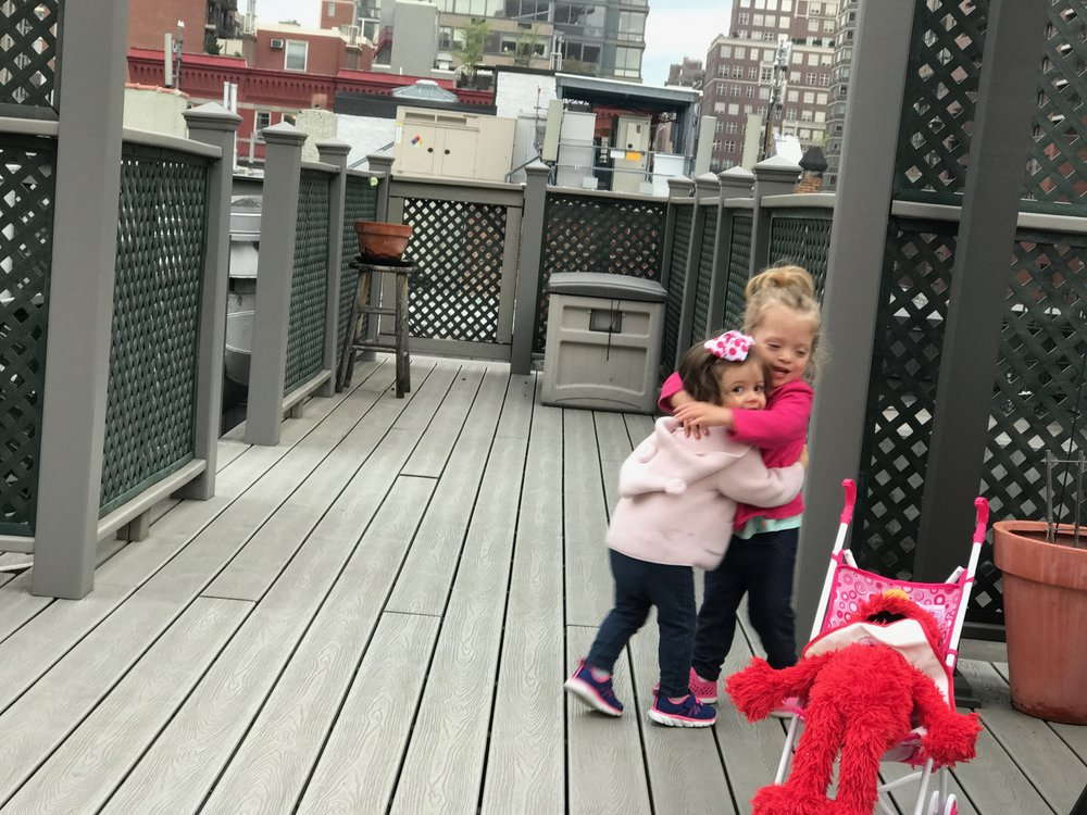 Lucie with Elle and Elmo on one rooftop...