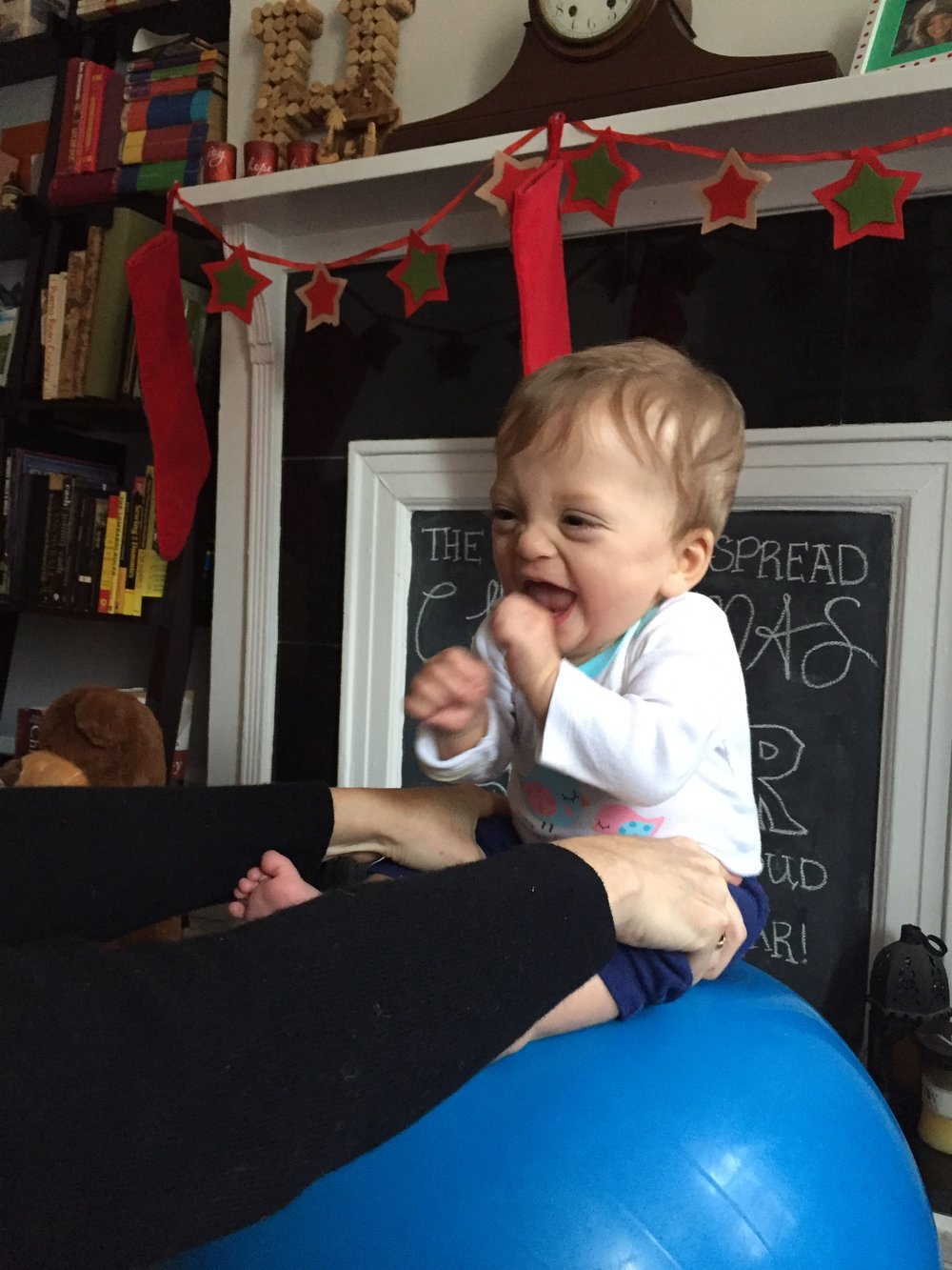 Singing a song on the ball, we captured a rare smile/ laugh! Bouncing can be fun, we promise!