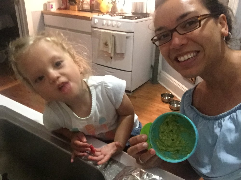 """Us making guacamole on my birthday while listening to Marc Anthony. Lucie loooooves """"abocados"""" and guac!"""