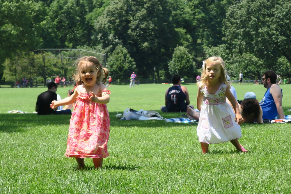 Elle and Lucie running around the Great Lawn in Central Park.