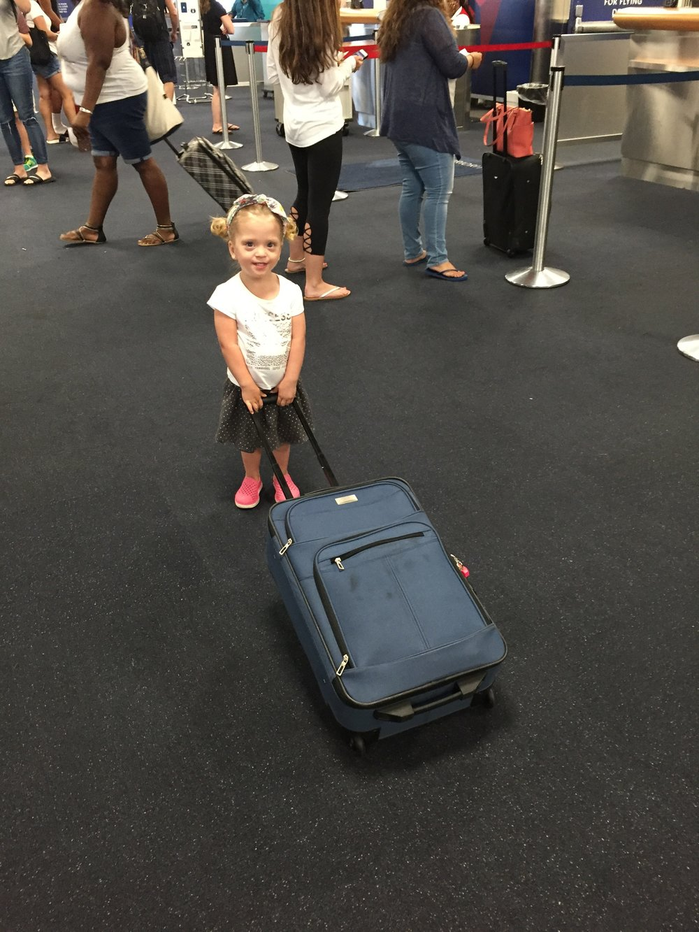 Lucie, ready to board the flight from NYC!