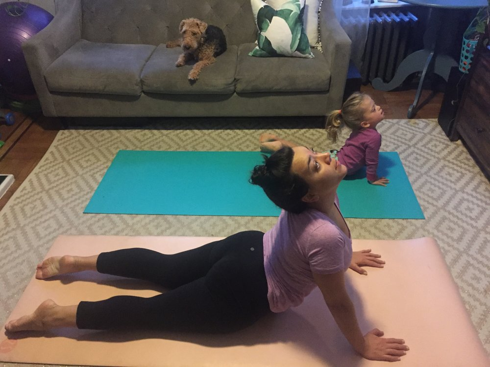 "Practicing Yoga together. Lucie knows the instructor on the DVD's name, so she'll say, ""Hi, Autumn!"""