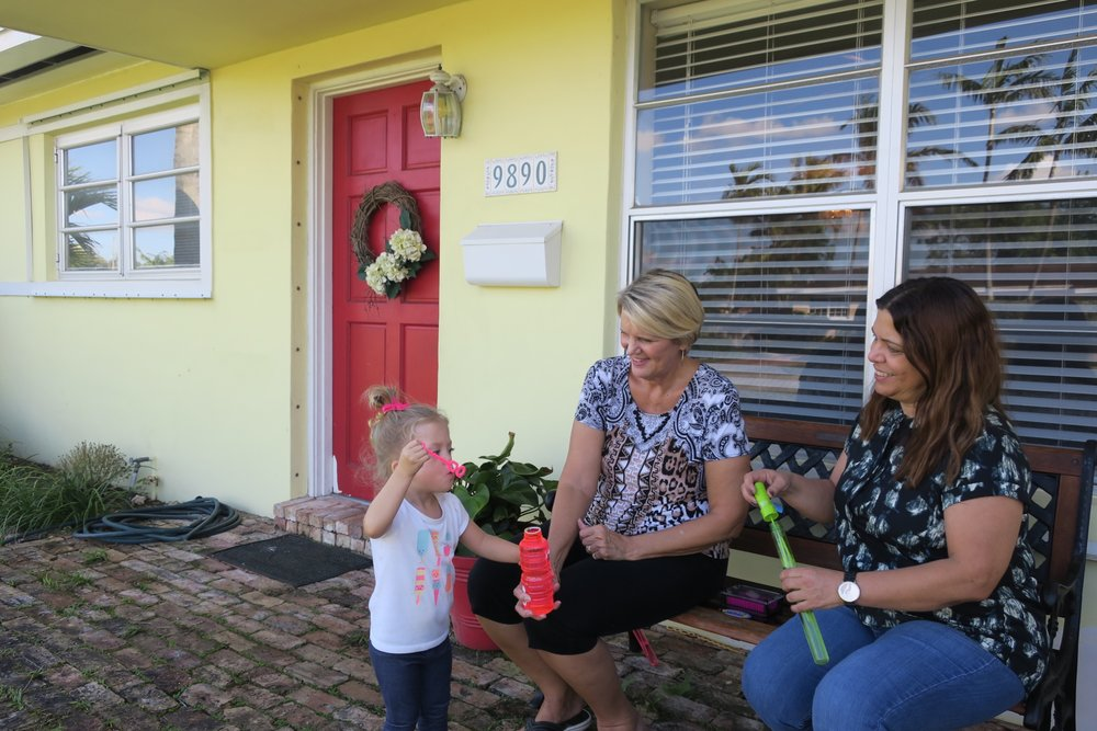 Blowing bubbles with Grandma and Abuela <3