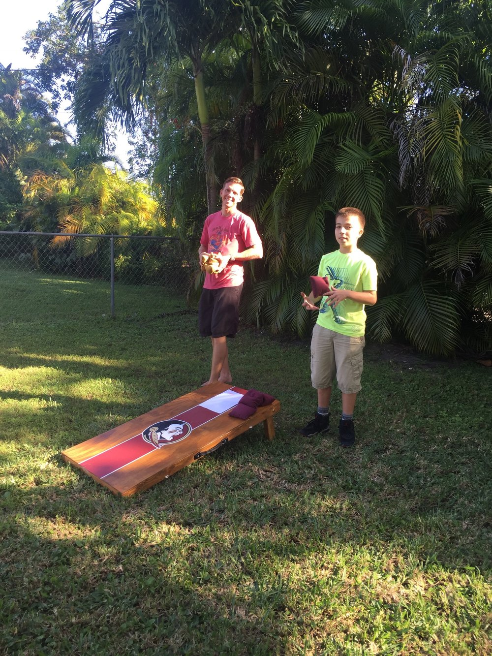 Cornhole in the backyard. Barefoot!