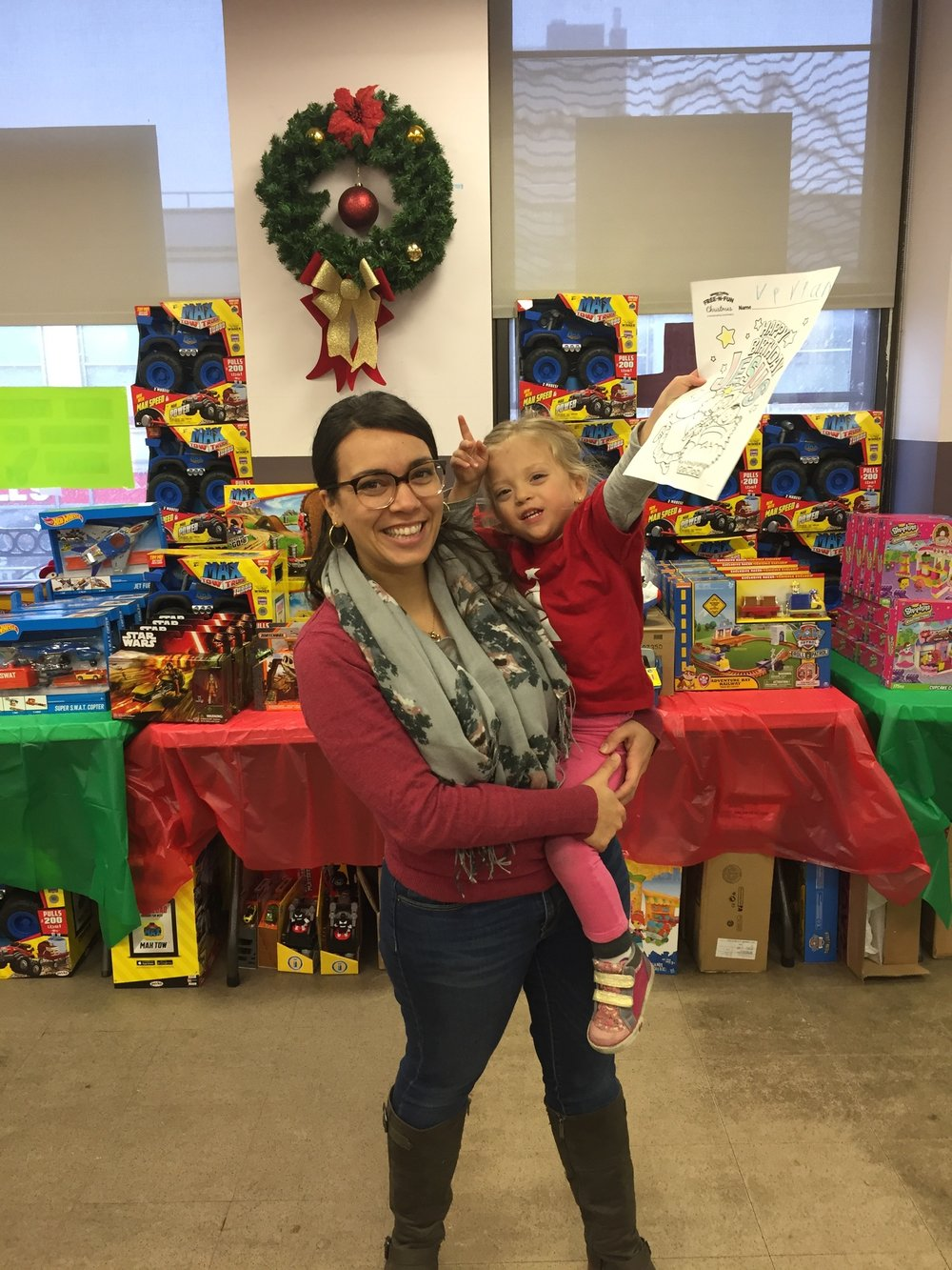 Mommy and Lucie volunteering at His Toy Store in Harlem with our church