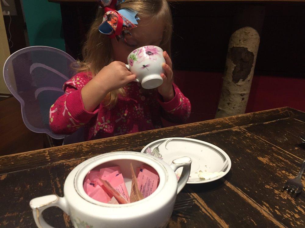 Enjoying tea over brunch at Alice's Tea Cup.