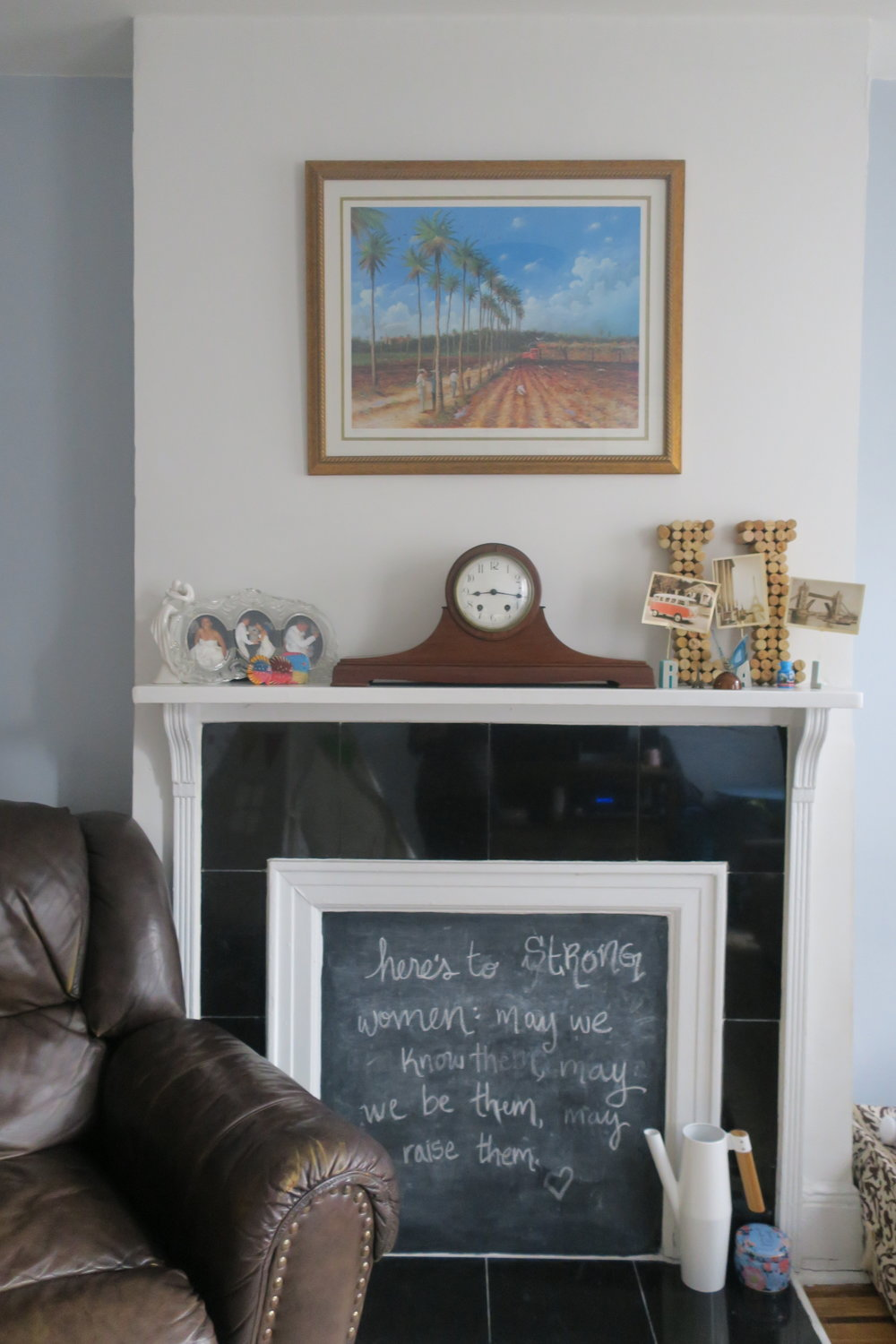 Love changing the chalkboard with the seasons. This was in honor of International Women's Day and Women's History Month! The clock is a family heirloom from Robby's grandparents. The painting is of the town of Aguirre, Puerto Rico where my Grandma Lucy grew up. (The three little fish by the clock represent Rob, me and Lucie.)