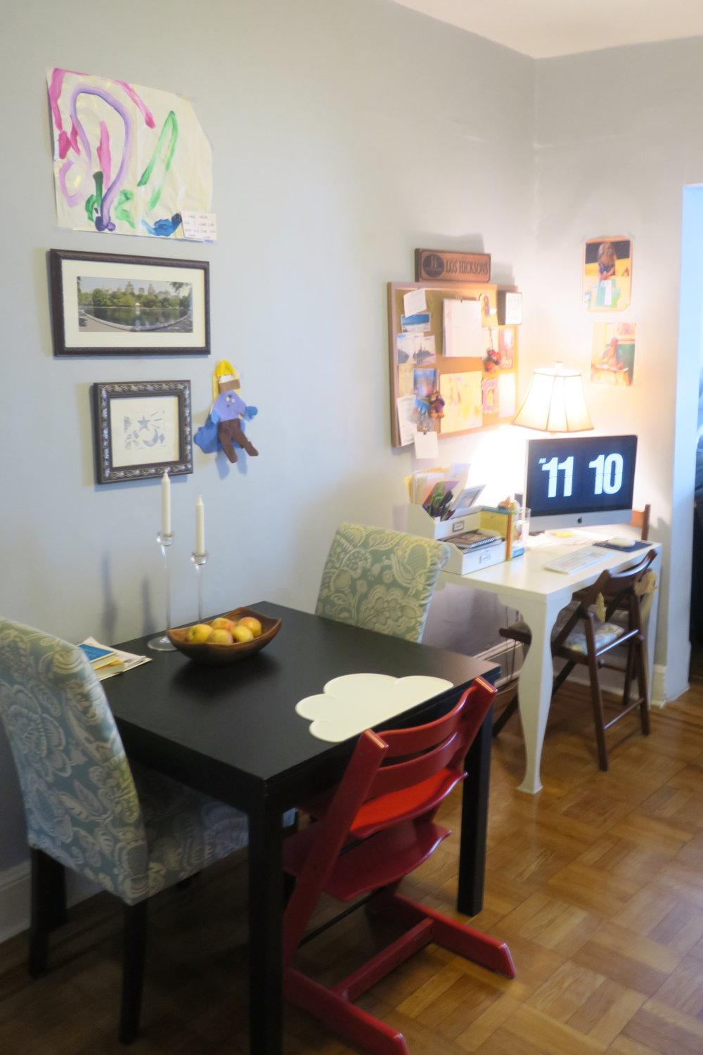 Across from her shelf/ play area is the dining room table and our desk space.
