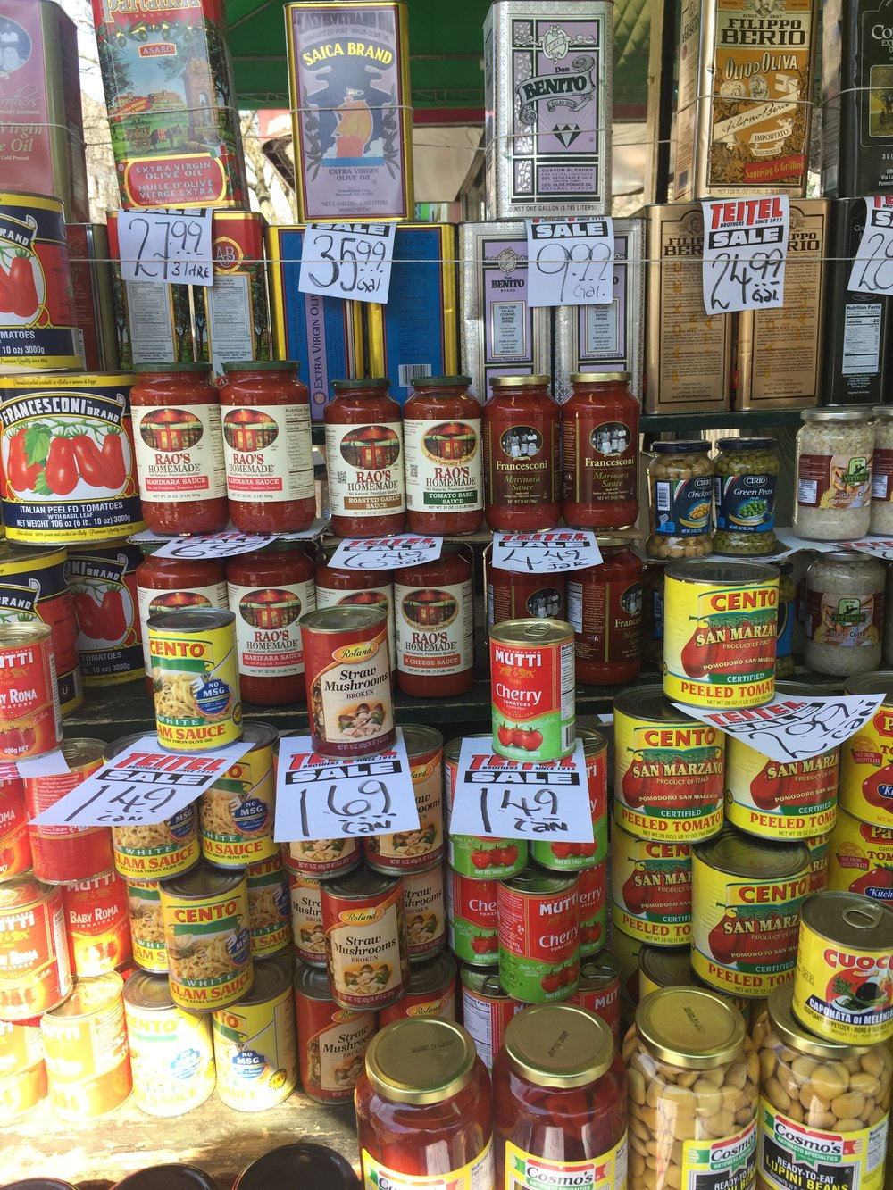 A display of Italian condiments and food, in Little Italy in the Bronx.