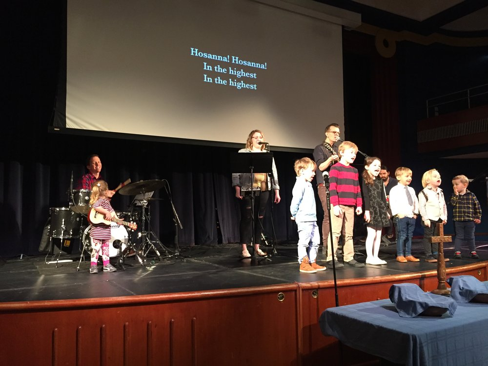 The kids at church singing on Palm Sunday. Lucie stayed near to her Daddy during the whole song. We're making progress; in December, she didn't want to sing on stage at all, and asked me to get her down half way through the song. Next time maybe she'll actually stand with the other kiddos.