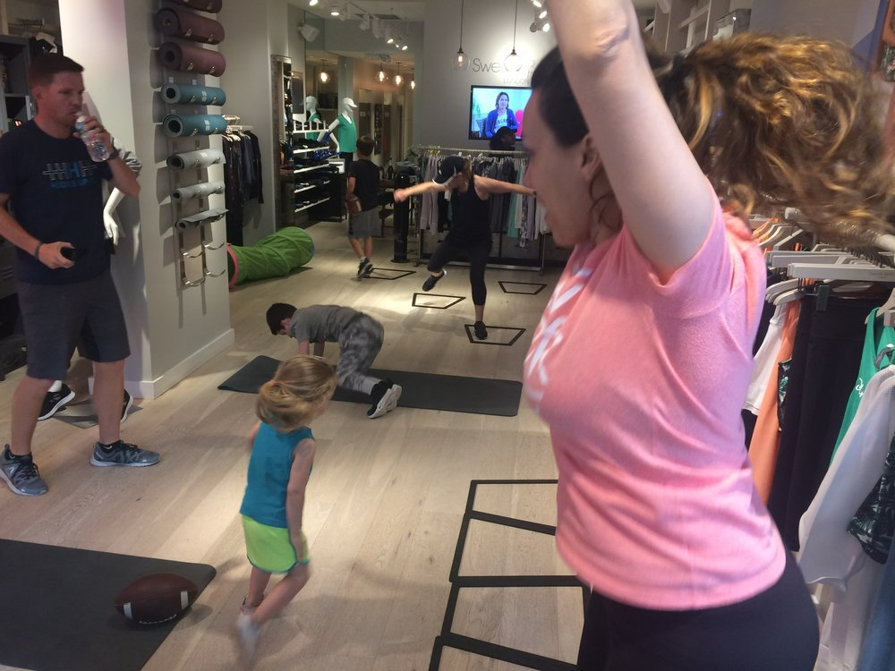 Having a blast at the special Mother's Day Huddle Up NYC workout at Sweaty Betty!