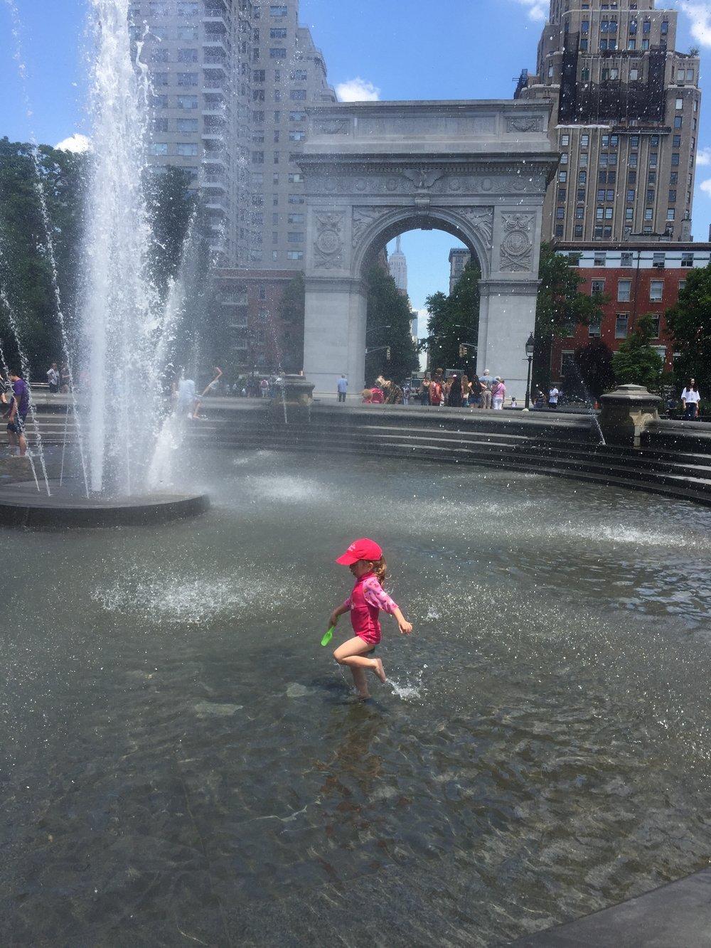 Splashing around the Washington Square Park fountain.