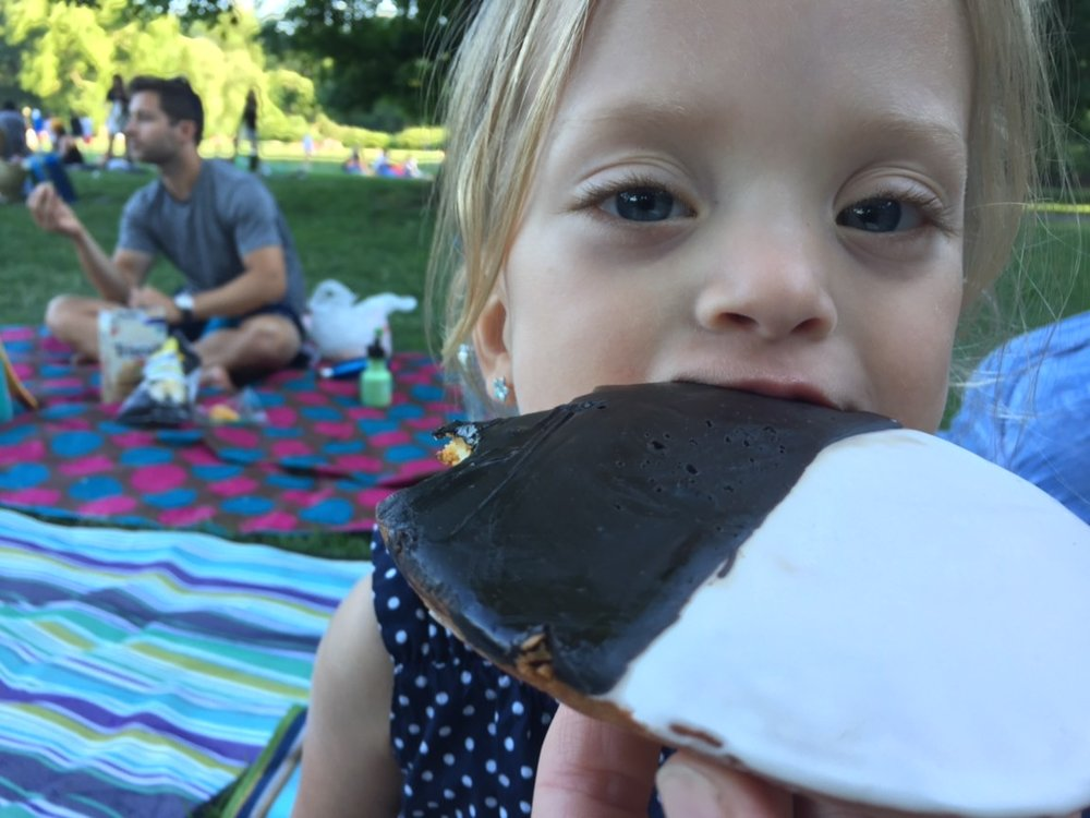 After the splash pad we decided to have an impromptu picnic in the park for dinner. We got a Black and White cookie for dessert and it was as BIG AS LUCIE'S FACE.