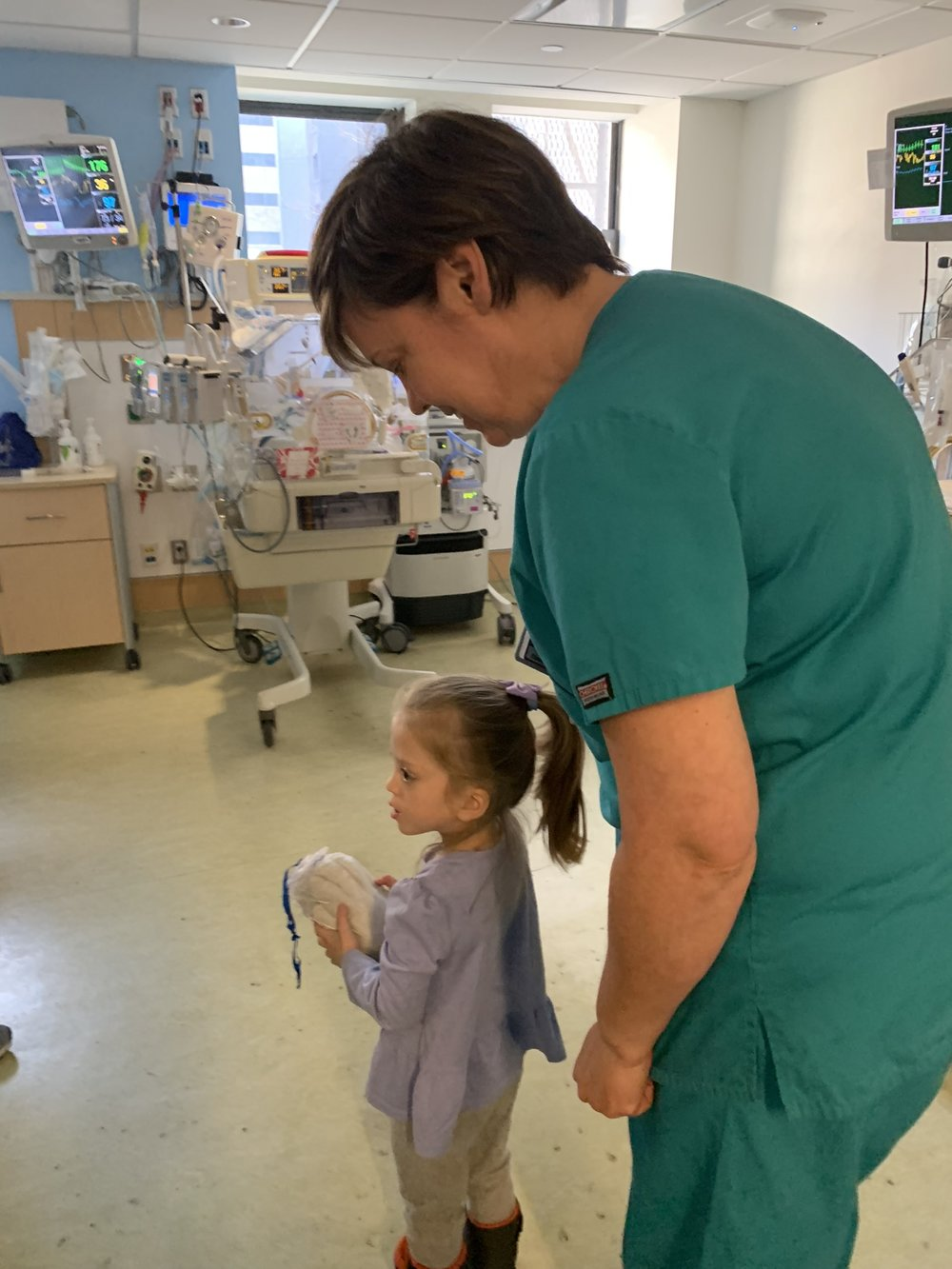 At the NICU with Lucie's former primary nurse, Liz, giving out a few Zaky's (a comforting tool), to some of the other little ones.