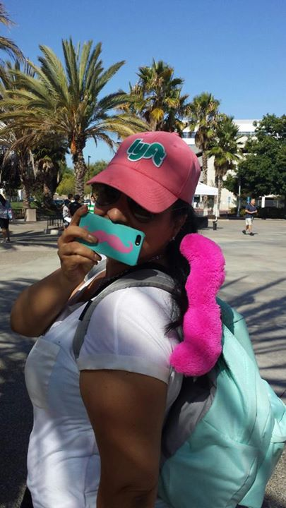 Meanwhile in SF, Paz showed her love for teal with a stylish phone case and matching backpack.