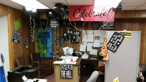 Anna decorated her friend's office before he got in.