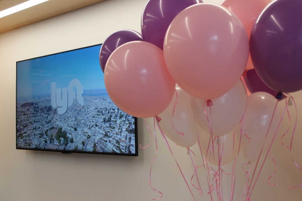 Recognize the city on the screen? HInt: It's an homage to Lyft's origins.