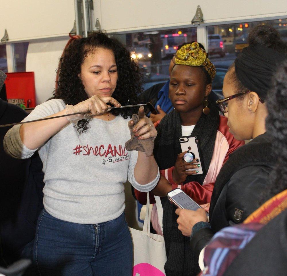 Patrice Banks (left) gave drivers in Philadelphia a mini auto-repair workshop