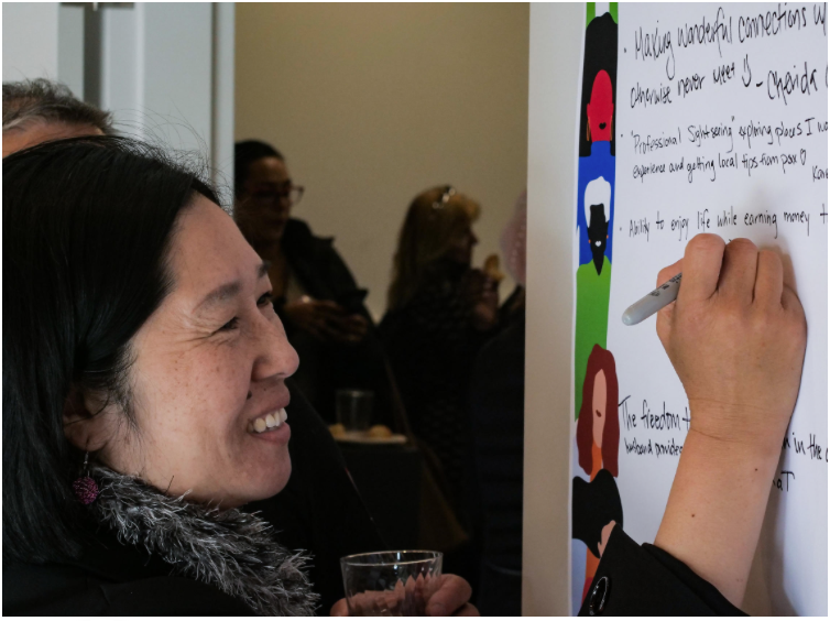 """A driver writes down her answer to what """"What drives you?"""" at the San Francisco Hub"""