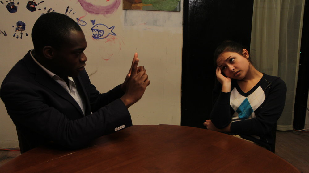 Debo Balogun as Tim and Grace Hutchings as Ana