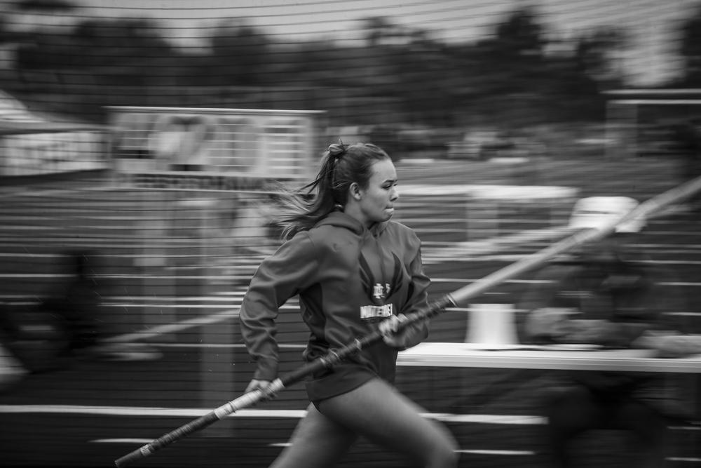 Mater Dei Pole Vault athlete in warmups.