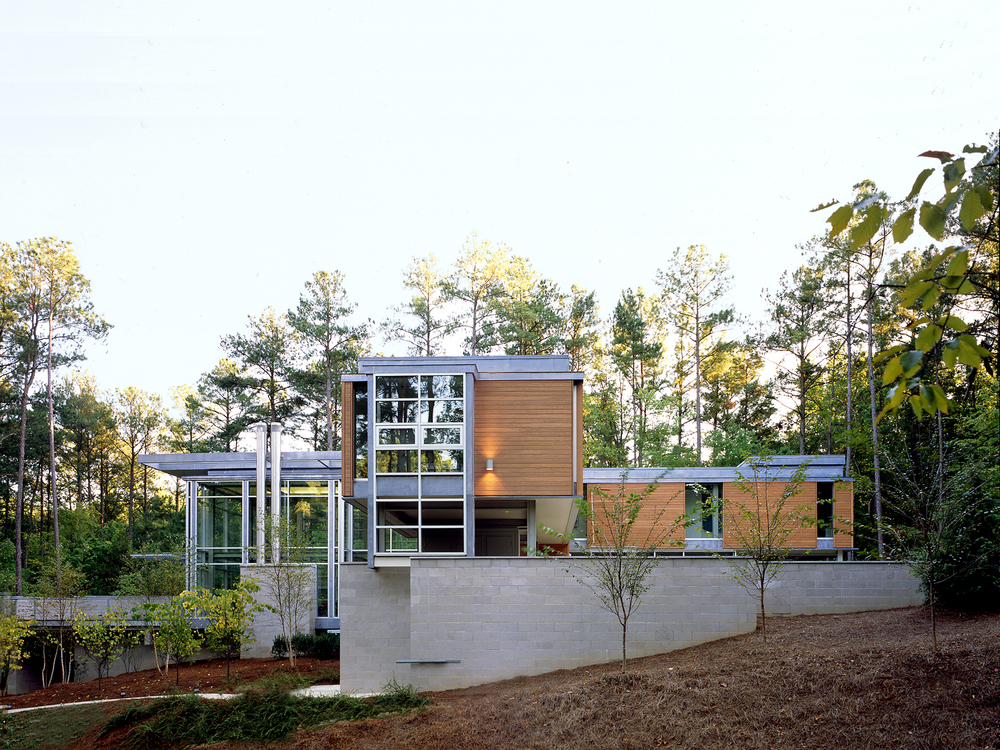 Paletz-Moi House   Durham, North Carolina   Architect:  HA    Program:   The 4,400sf (440m2) house is set on a steeply sloped site in a heavily wooded area.  The programs included are a 800sf double-height living and dining room, kitchen, a 400sf office for a writer, a 500sf screening room for a film critic, a library, and 3 bedrooms.      Client:   Withheld