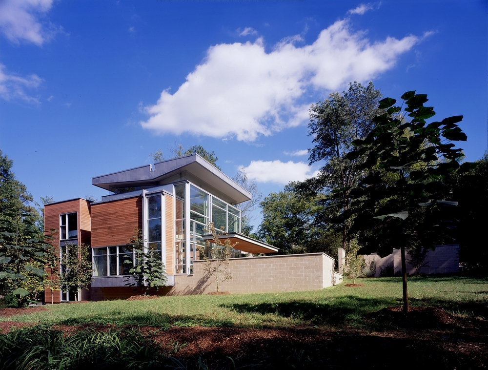GK House   Chapel Hill, North Carolina   Architect:  HA    Program:   This 3,700sf (370m2) house is located in the historic district of Chapel Hill, North Carolina.  Composed of two primary volumes, a glass cube for living and dining  and a rectangular wooden volume with bedrooms, kitchen and informal dining area.          Client:   Withheld