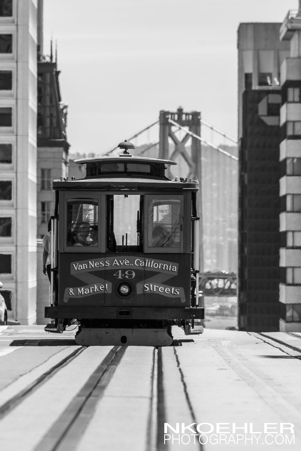 Slept in and enjoyed Fishermans Wharf. In afternoon took the Van Ness and California cable car to this destination where I was able to capture this shot of the cable car in front of the Bay Bridge in downtown San Francisco.