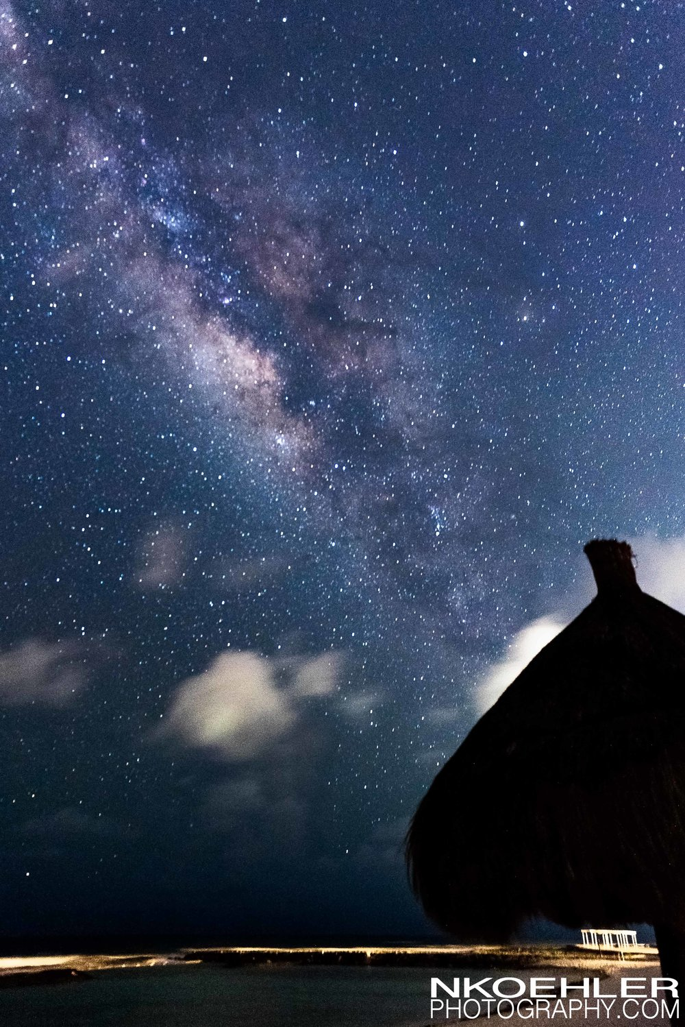 Milky Way shooting out of a beach hut during one of the warm summer nights.