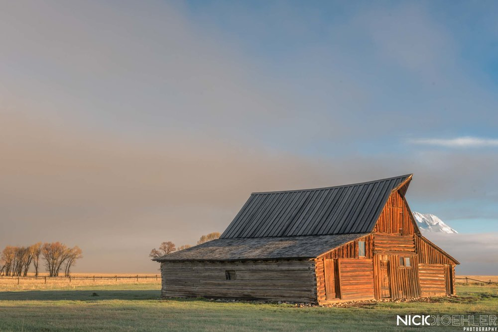 Grand Teton National Park: One of the fancy barns in front of the mountain range. A foggy sunrise was what I received.