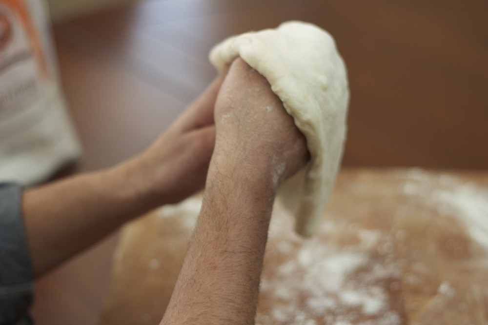 Grab the dough and place it on the back of your knuckles.