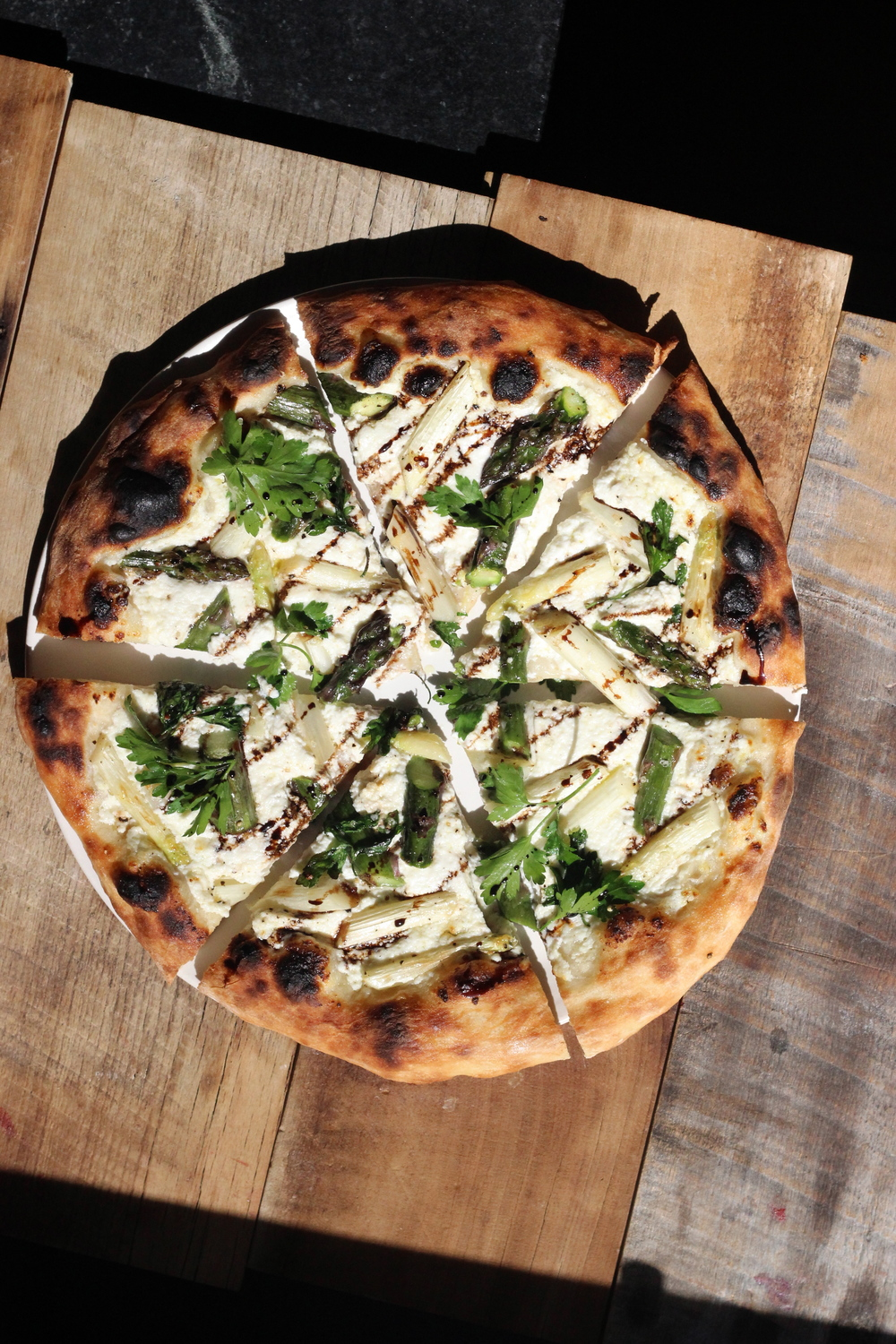 asparagus pizza on a Baking Steel
