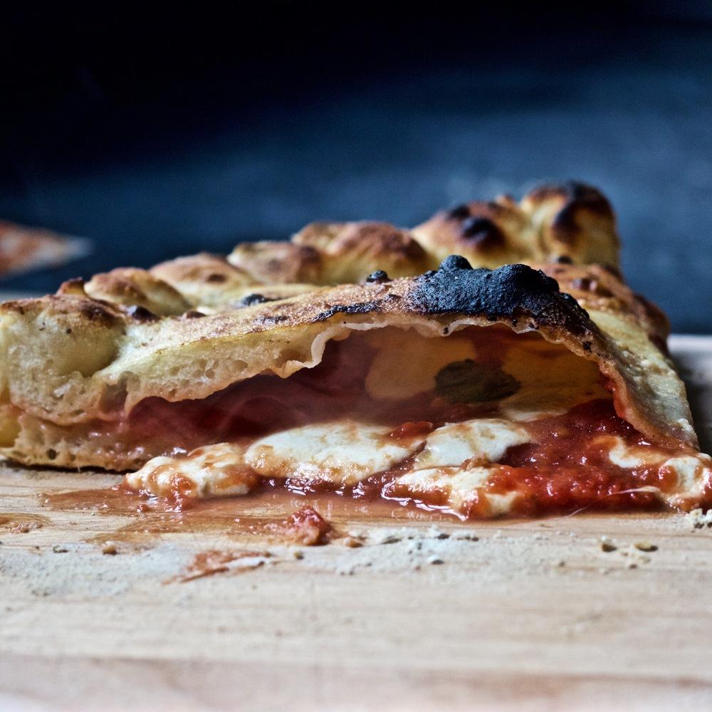 crispy calzone with tomato sauce and fresh mozzarella
