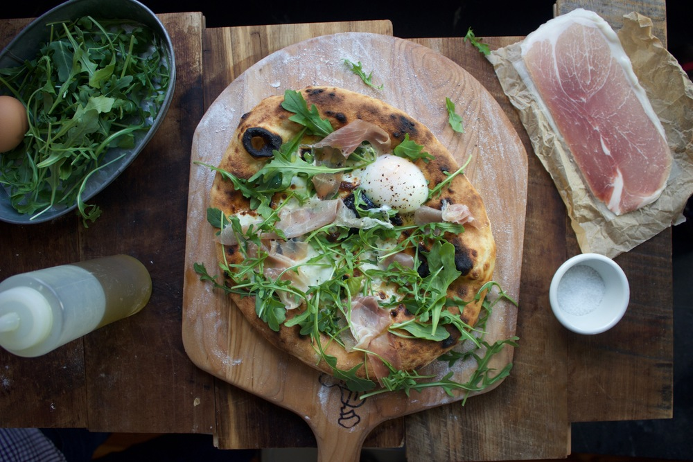 arugula, prosciutto and sous vide egg pizza baked on a Baking Steel