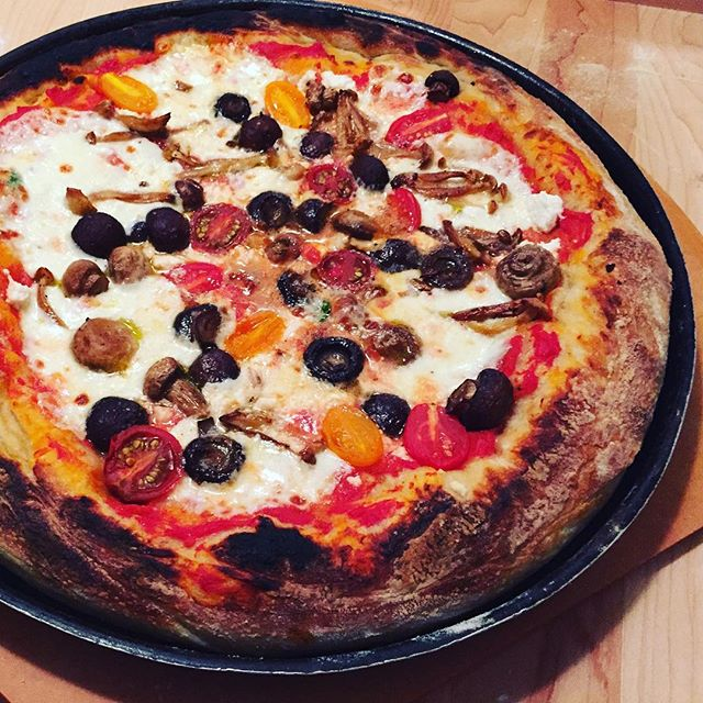 @domenicacooks  crust game is on point! Mushrooms, tomato, mozzarella and ricotta. Yum.