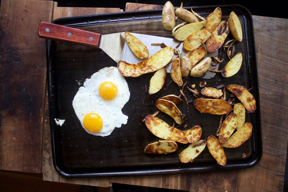 Baking Steel Griddle with potatoes and eggs