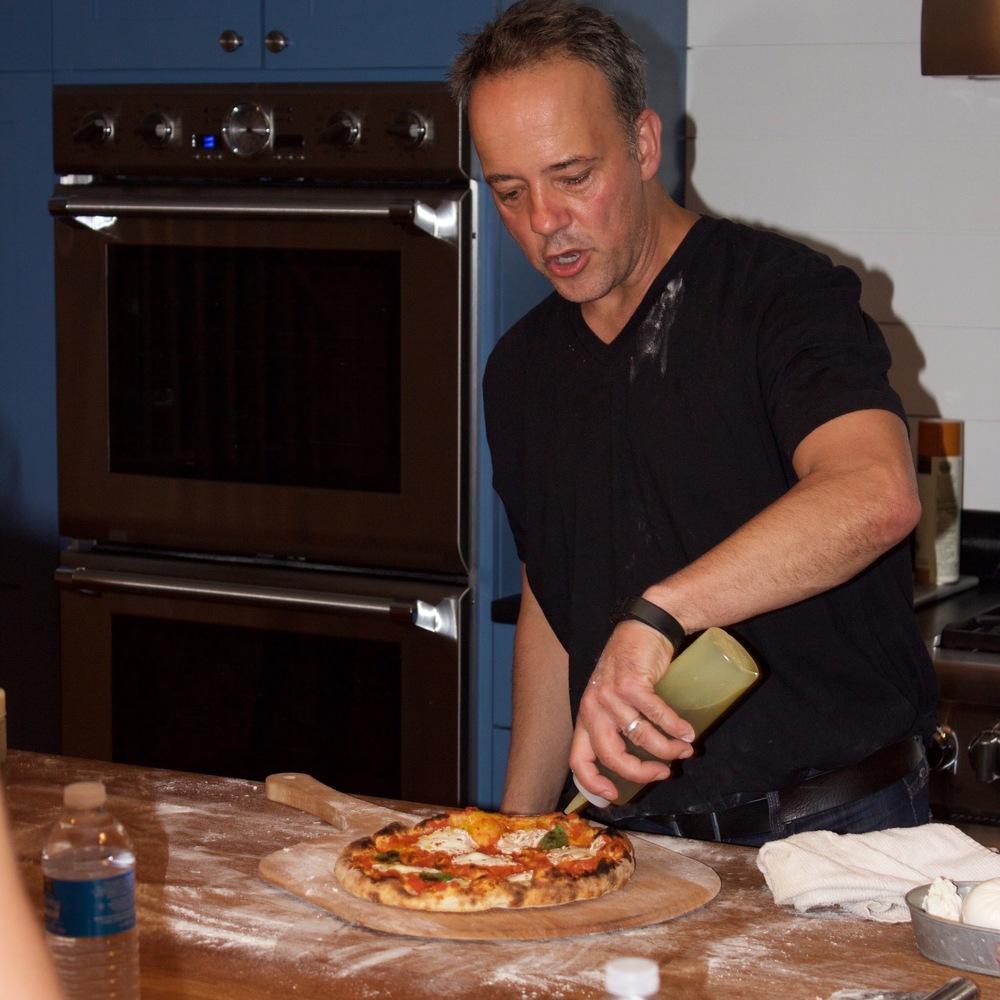 Andris making pizza