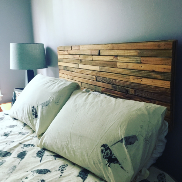 "A headboard made from wooden stakes makes a beautiful, inexpensive addition to your preschooler's new ""big girl"" or ""big boy"" bed."
